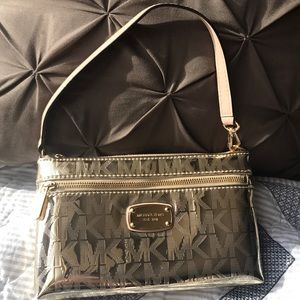 Michael Kors golden monogrammed clutch